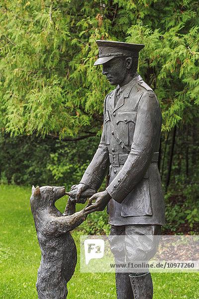 'Bronze statue of Winnie the Pooh with Lieutenant Harry Colebourn in Assiniboine Park; Winnipeg  Manitoba  Canada'