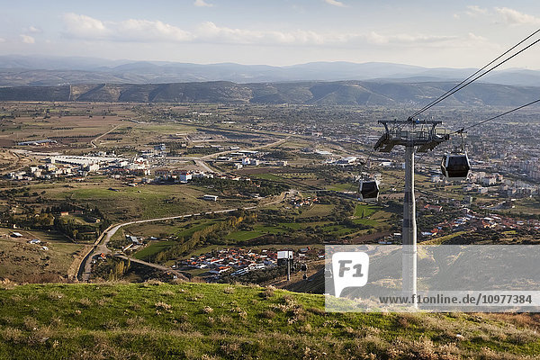 'Cable car traveling over the site of an ancient city; Pergamum  Turkey' 'Cable car traveling over the site of an ancient city; Pergamum, Turkey'