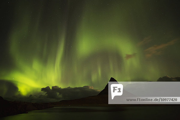 'Northern lights over top of Kirkjufell  the most photographed mountain in Iceland; Iceland'