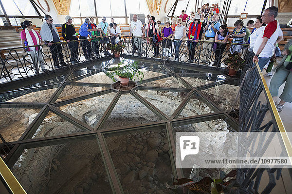 'Tourists look down into what is believed to be the ruins of Peter's house; Capernaum  Israel' 'Tourists look down into what is believed to be the ruins of Peter's house; Capernaum, Israel'