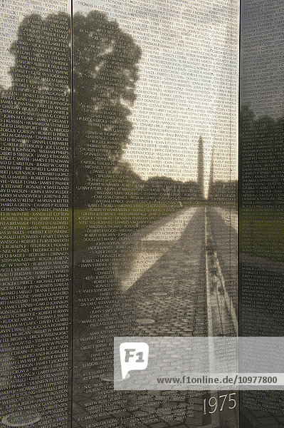 'The Washington Monument reflects in the surface of the wall at the Vietnam Veterans Memorial; Washington  District of Columbia  United States of America'