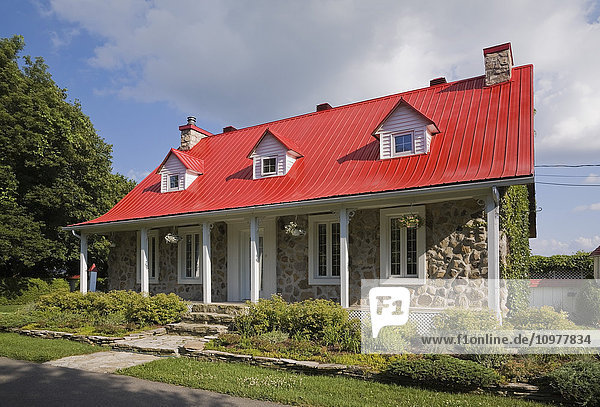 1978 Replica Of An Old Canadiana Cottage Style Fieldstone Residential Home  Quebec  Canada. This Image Is Property Released. Pr0128