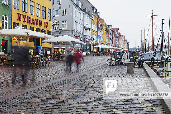 'Nyhavn is the famous waterfront canal in Copenhagen  with colourful seventeenth and eighteenth century townhomes lining the canal; Copenhagen  Denmark'