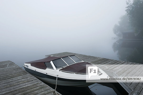 Boat At Dock On Misty Morning  Dudley Bay  Lake Muskoka  Ontario