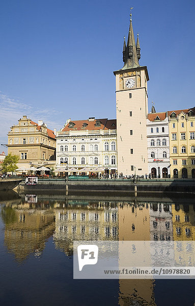 'Clock Tower And Terraces Along The Vltava River In Old Town District; Prague  Czech Republic'