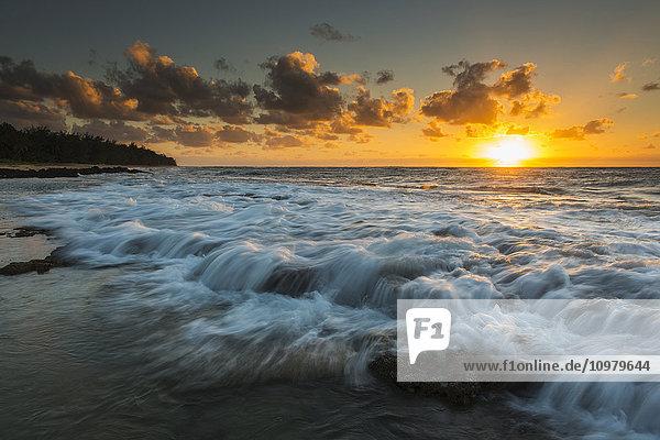 'Sunrise and surf on the east coast of Kauai; Kauai  Hawaii  United States of America'
