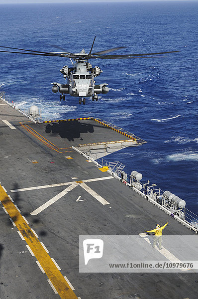 'A CH-53 Sea Stallion helicopter comes in for a landing on the flight deck of the USS Peleliu (LHA-5) out in the Pacific Ocean; Hawaii  United States of America'