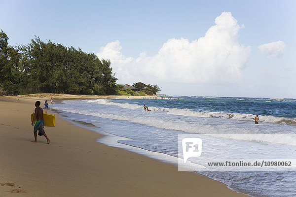 'Boogie boarders enjoying the waves at Laie Beach Park on the north shore of Oahu; Oahu  Hawaii  United States of America'