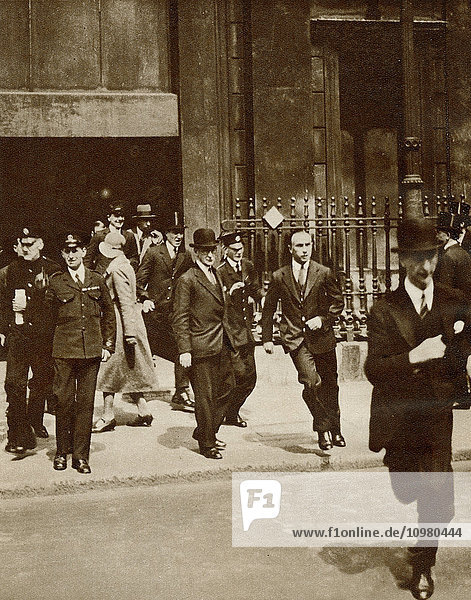 The great financial crisis of 1931  clerks rushing out of the bank after the fall of the bank rate to tell the brokers on the Stock Exchange. From The Story of 25 Eventful Years in Pictures published 1935