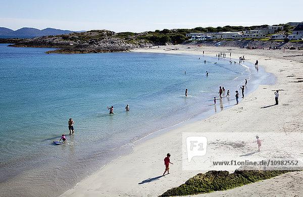 'People enjoying a white sand beach; County Kerry  Ireland'