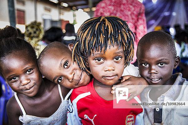 'Portrait of four Ugandan children; Gulu  Uganda'