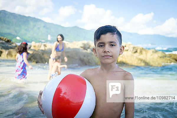 Portrait of boy with beach ball