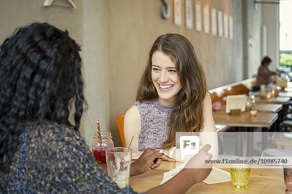 Two friends meeting in cafe