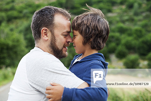 Happy father and little son face to face