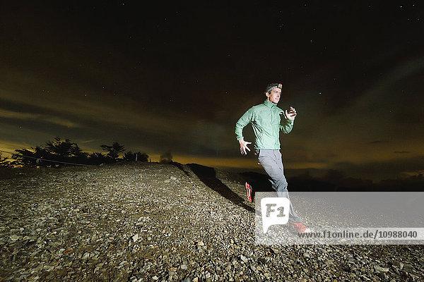 Caucasian man running at night at Mount Daibosatsu  Yamanashi Prefecture  Japan
