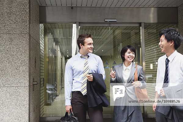 Multi-ethnic business people leaving the office
