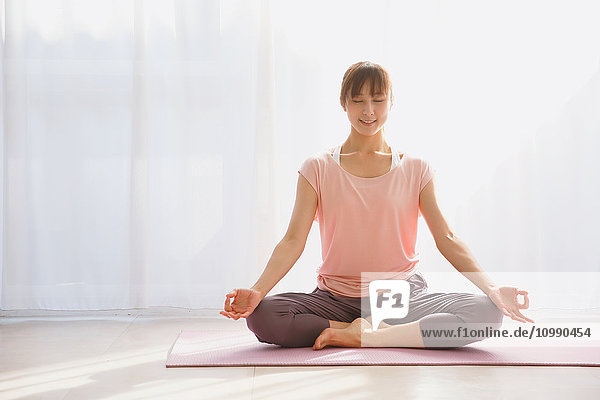 Young Japanese woman practicing yoga