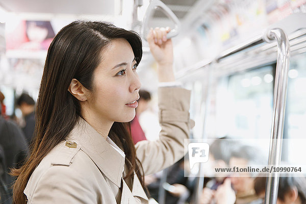 Young attractive Japanese woman on the train
