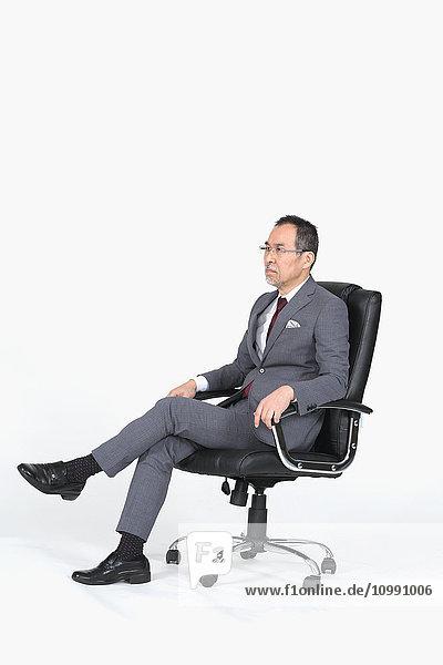 Japanese senior businessman on white background