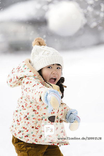 Kid playing in the snow