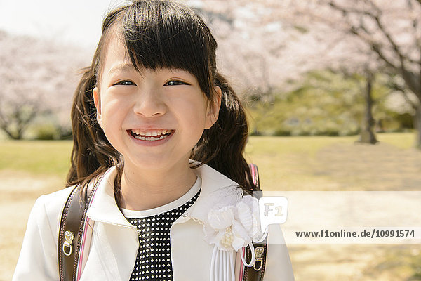 Japanese elementary school student and cherry blossoms