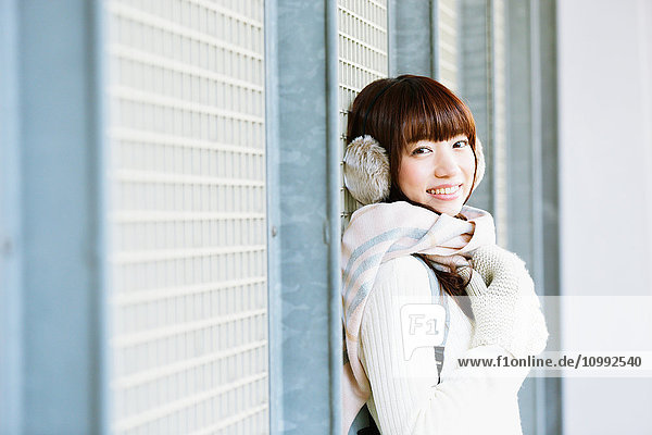 Attractive Japanese woman with muffler on a Winter sunny day