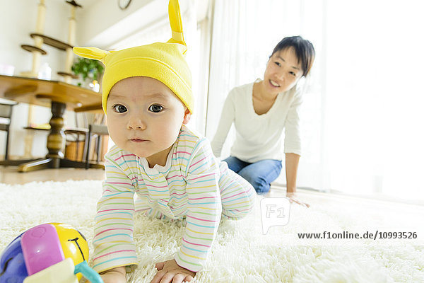 Toddler with mum in the house