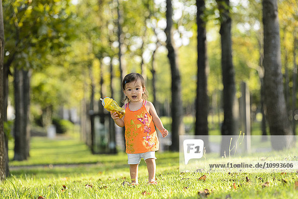 Kid playing in a city park