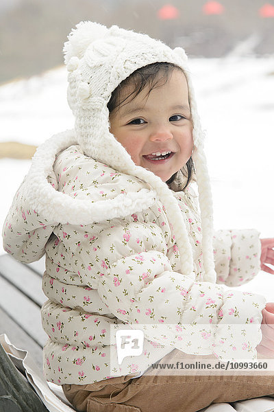 Kid playing on snow