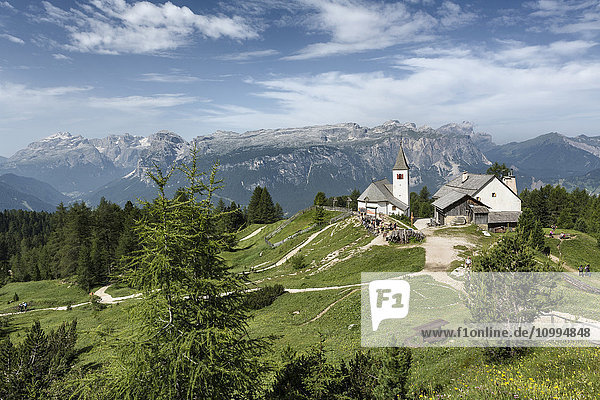 Scenic view of mountains with the beautiful little Church of the Holy Cross  Badia Valley  Dolomites  South Tyrol  Italy