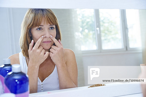 Woman looking in a mirror.