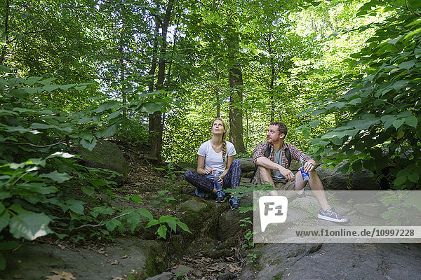 Couple resting in forest