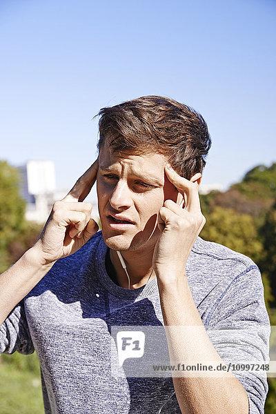 Man with headache.