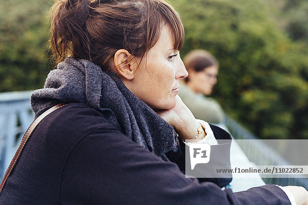 Side view of woman looking away from observation point