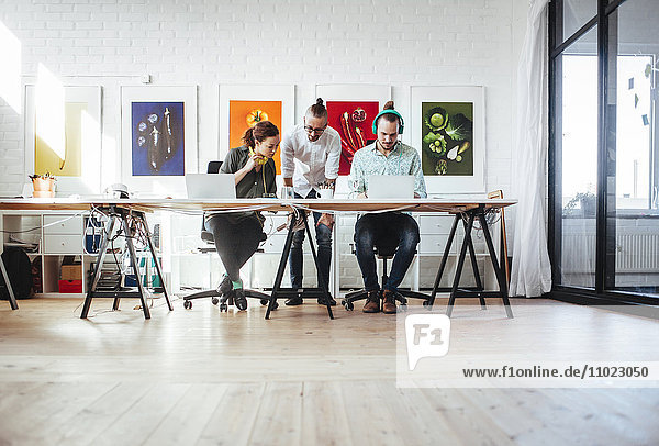 Creative business people working together in office