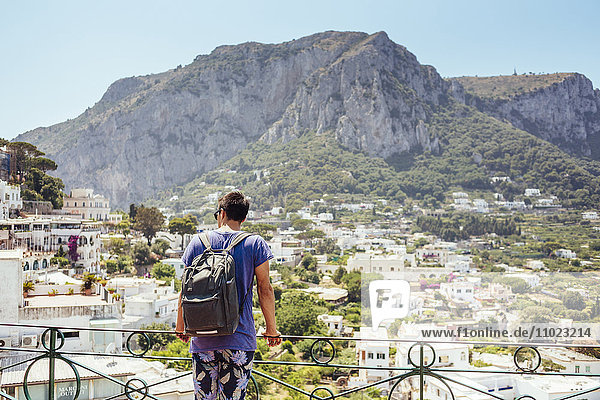 Rear view of man against mountain at Amalfi Coast