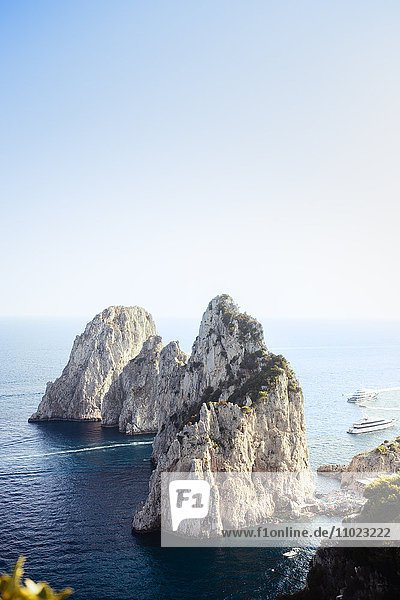 Scenic view of rock formations at Capri island against sky