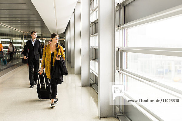 Business people walking at airport