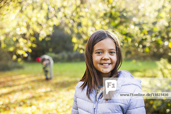 Portrait of girl smiling in forest during autumn