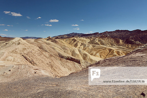 Scenic view of Death Valley National Park against blue sky