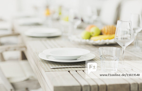 Placesettings on bleached wood dining table