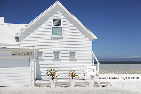 White beach house with sunny ocean view