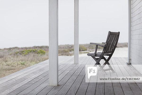Wooden folding chair on beach house deck