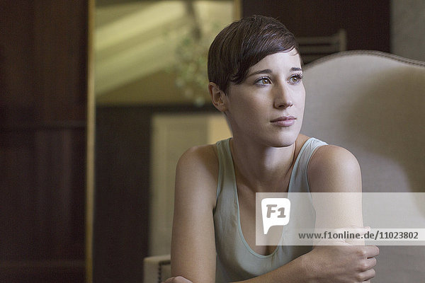 Pensive brunette woman looking away