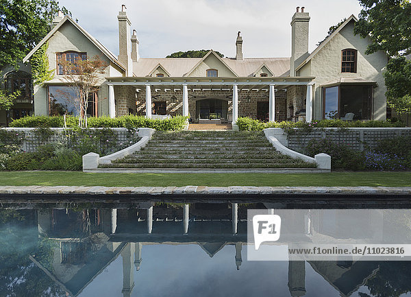 Home showcase exterior with swimming pool