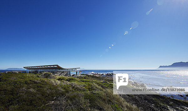 Luxury house with ocean view under sunny blue sky