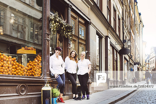 Sweden  Stockholm  Gamla Stan  Portrait of three female cafe workers standing outdoors