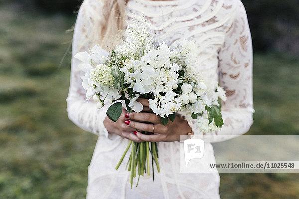 Bride holding bouquet Bride holding bouquet