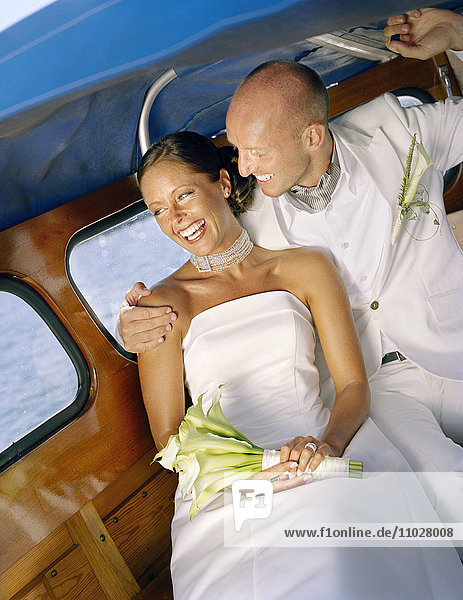 A bridal couple in a boat.