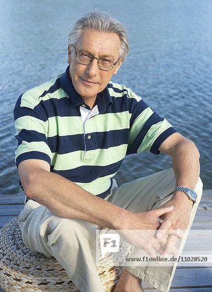 A smiling man  sitting  portrait.